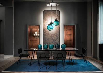 Gio Pagani - tavolo e sedie con struttura in tubi metallici